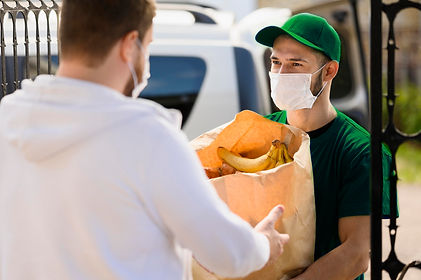 delivery-man-handing-out-groceries-to-cu