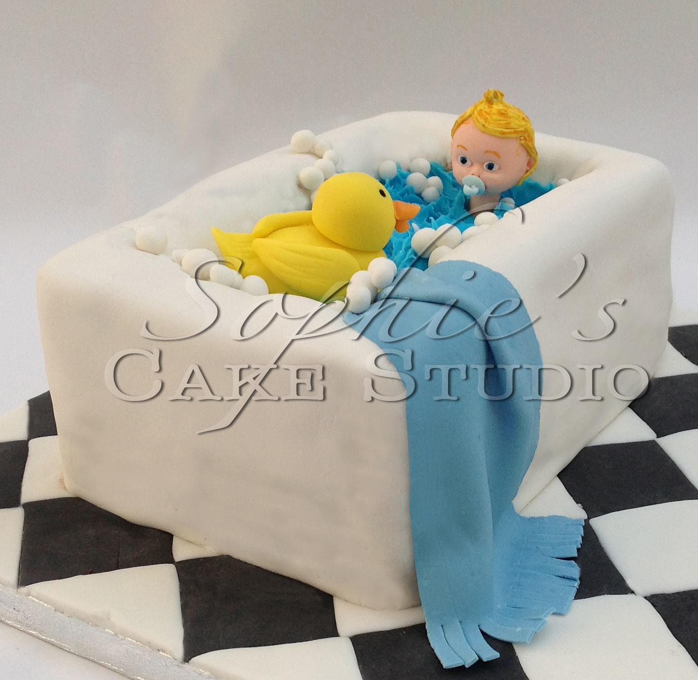 baby boy in bath cake