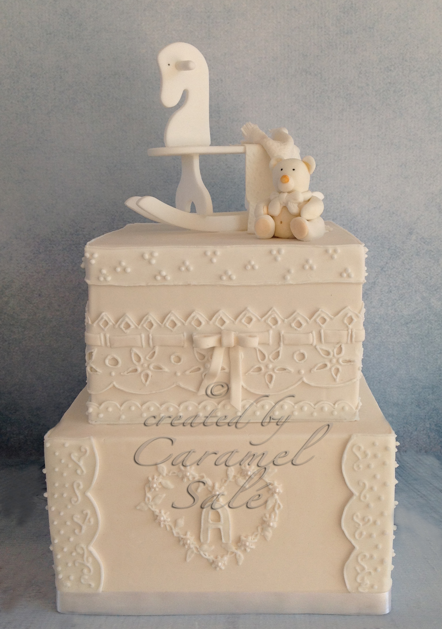 white baby cake broderie anglaise