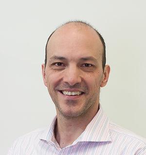 Dr Paul Grinzi