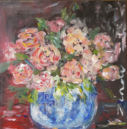 """Preach roses in blue pot"""