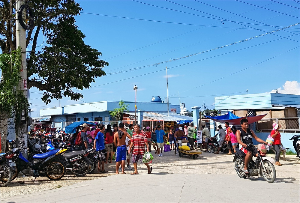 Motorcyclists gather at Alona Beach entrance in Bohol