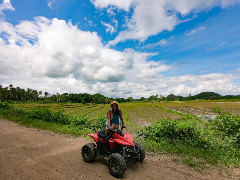 Quad biking through the chocolate hills in Bohol, Philippines
