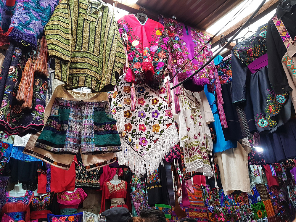 Beautifully woven clothes, some of which have finely hand sewn colourful designs
