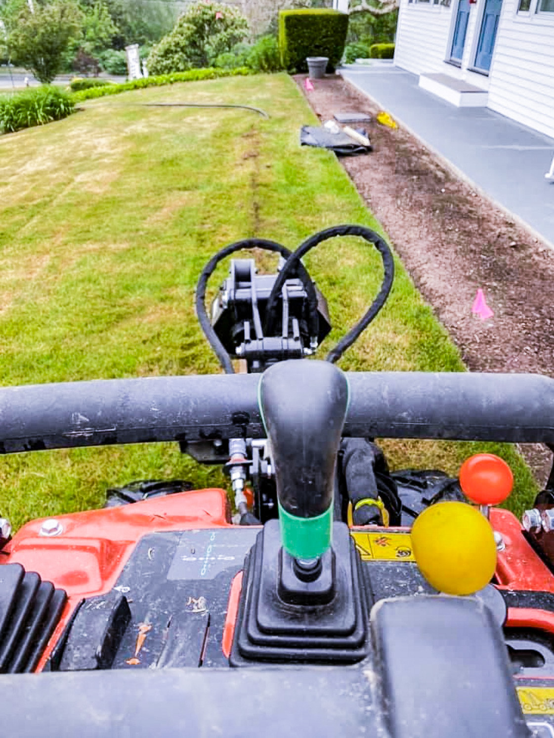Mike Santos Irrigation - Ditch Witch running pipe on existing lawn