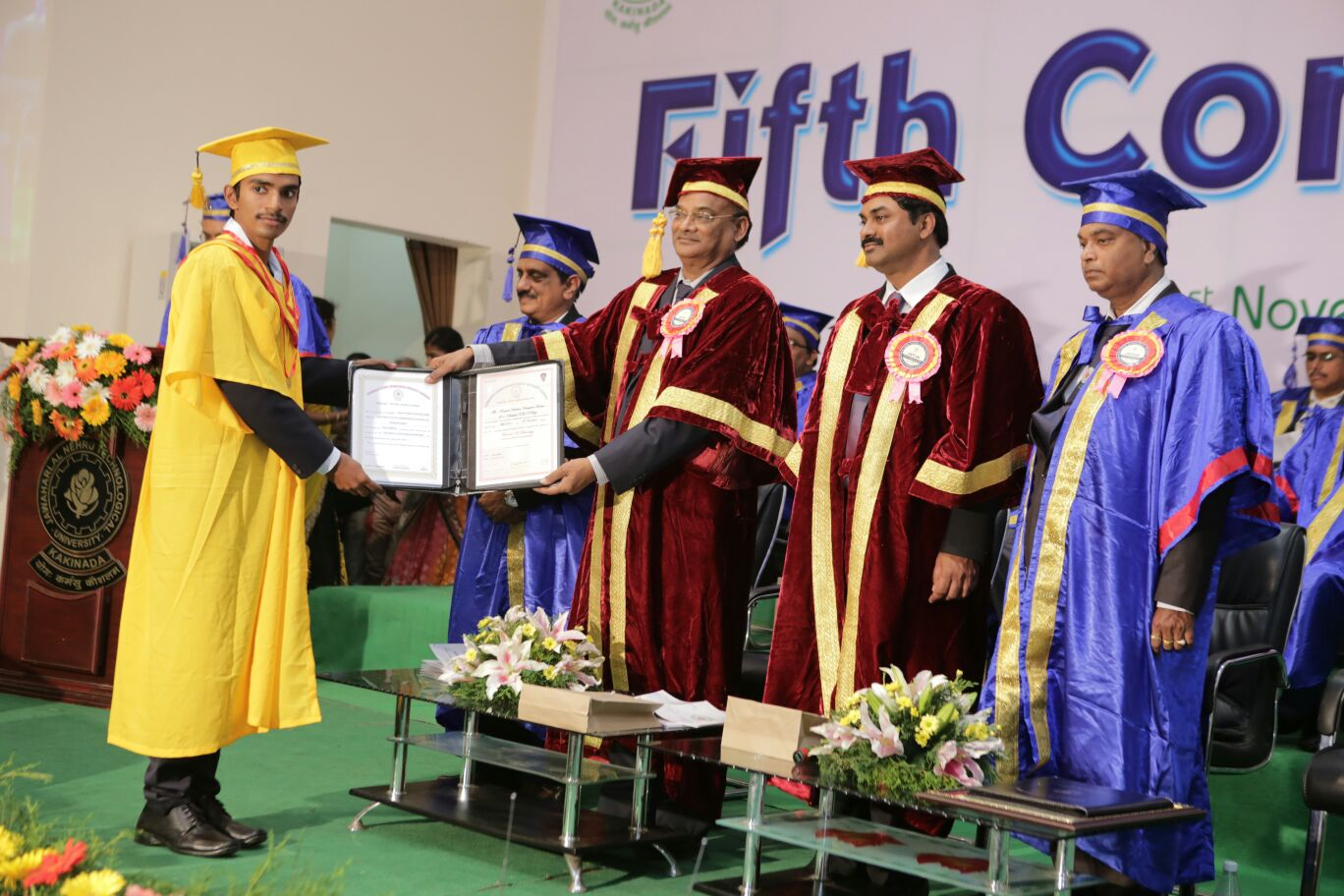 PVN VARMA receiving Medal from Vice Chan