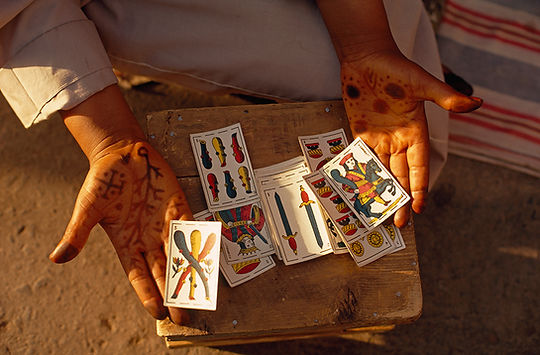 A fortune teller displays her cards in J