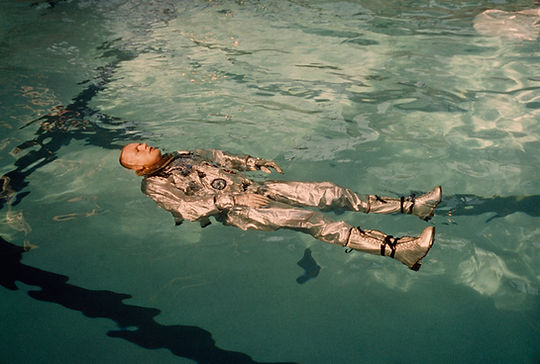 Astronaut Neil Armstrong floats in his s