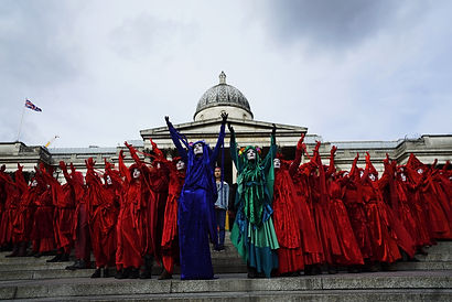 Red Brigade Invisible Circus red rebels extinction rebellion XR London National Museum
