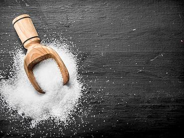 Black wood background salt and scoop.png