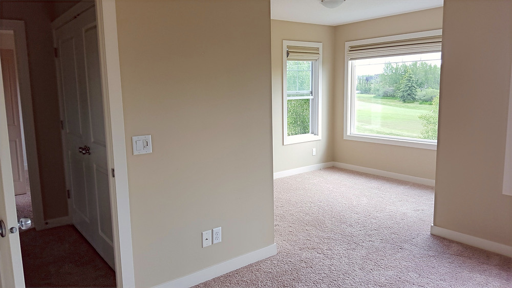 Empty sitting area attached to a master bedroom