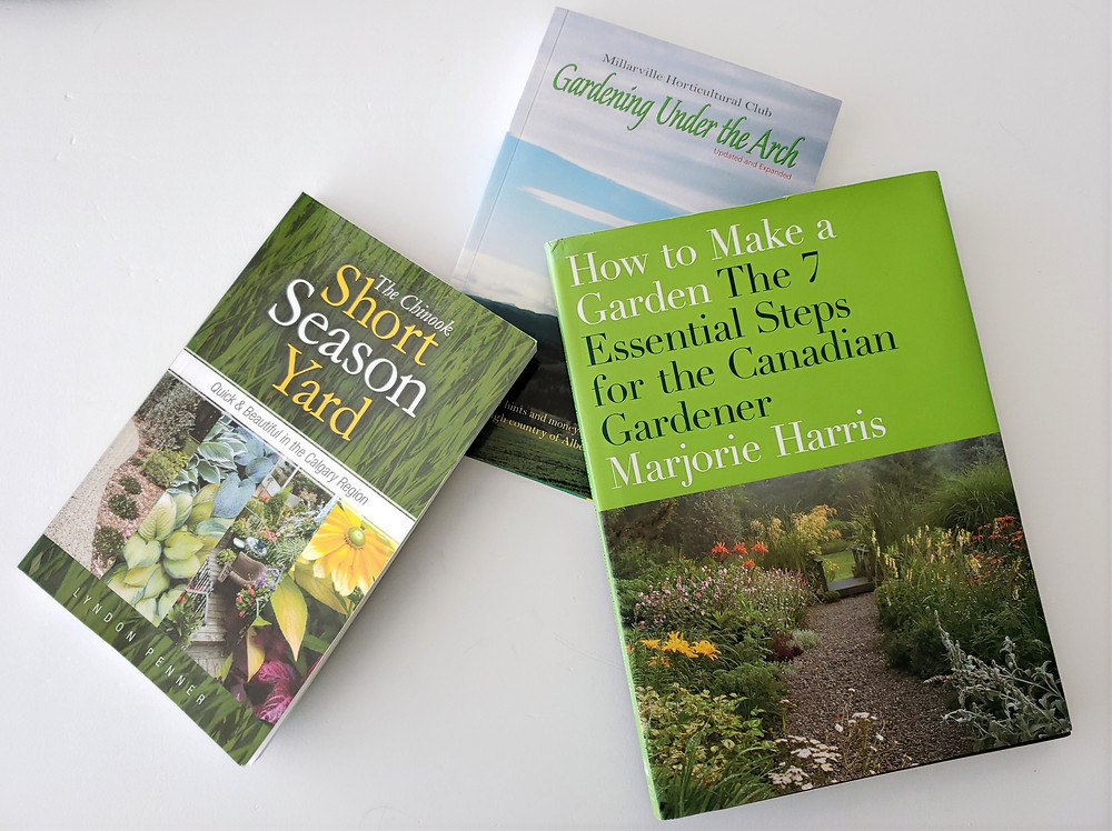 Tree gardening books spread on a table