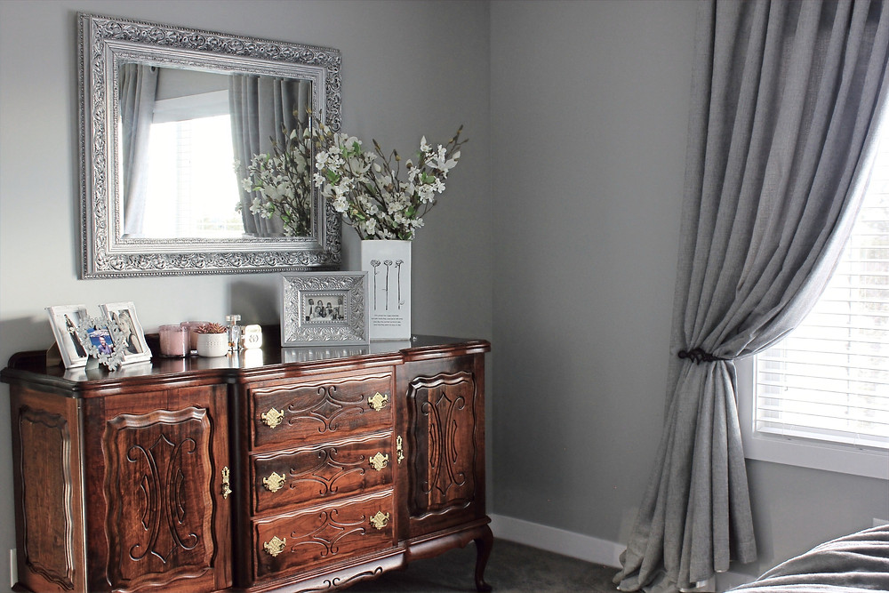 Antique sideboard used as a dresser in a master bedroom