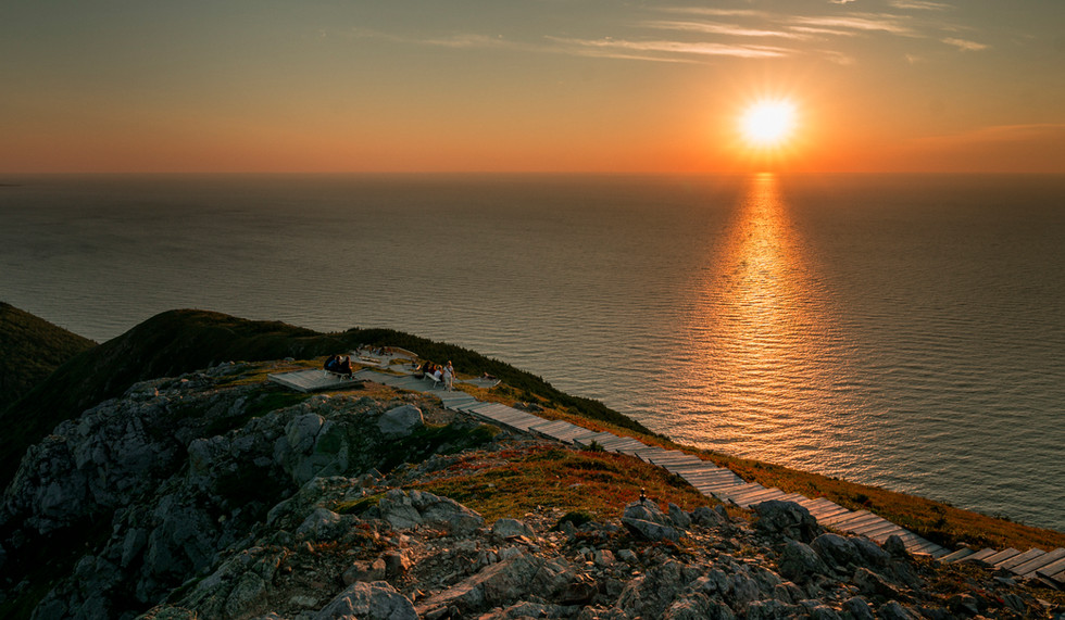 Go on a sunset hike surrounded by dramatic coastal views