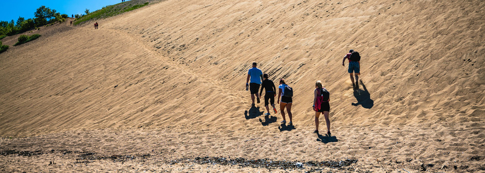 Traverse the sand dunes and swim in the St. Laurent
