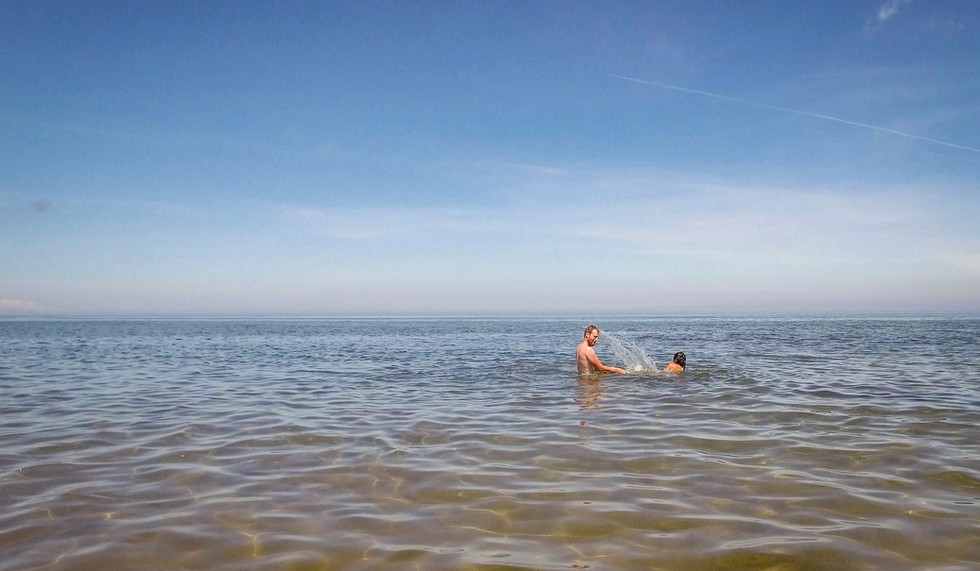 Swim and listen to the singing sands at the best beach in Canada