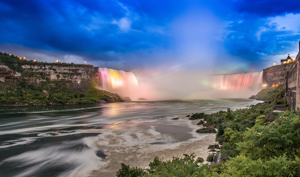 Holiday Travel Canada and See Night view of Niagara Falls when it is lit up with coloured lights Canada Horseshoe Falls