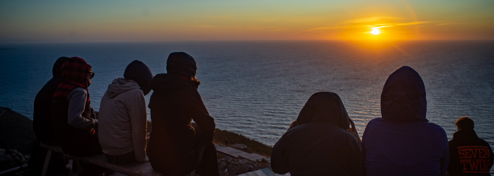Go on an incredible sunset hike surrounded by dramatic coastal views