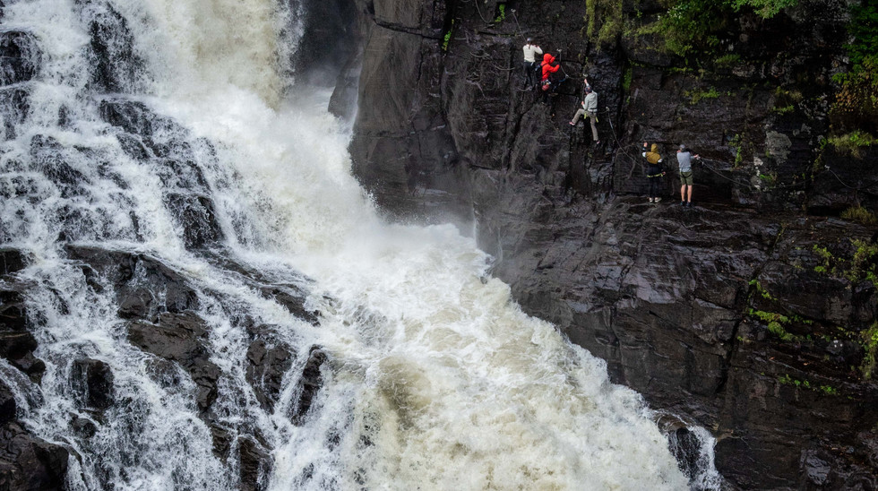 Via Ferrata across and through a canyon, right beside a gushing 74-meter waterfalll