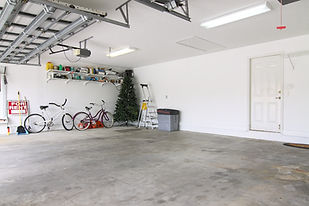An almost empty garage to be used as sto