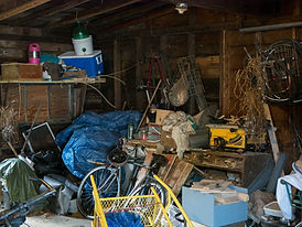 Dirty old wooden garage or shed filled w