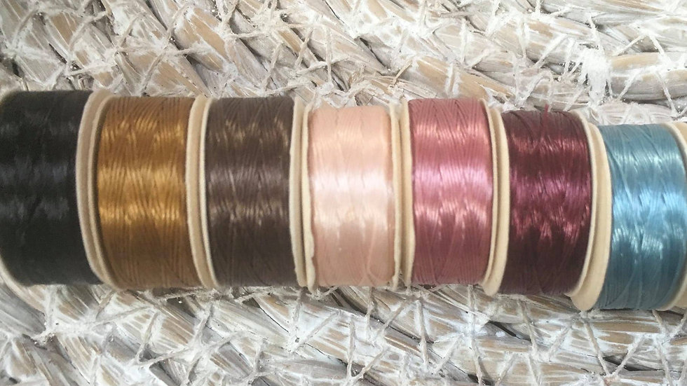 Seven Reels Of Nymo B Thread in these colours