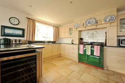 The wine fridge has room for plenty of bottles of rosé. Please note, the AGA in this photograph has been replaced by a seven ring, three door electric oven