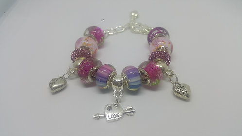 Bracelet with beads and 3 hearts