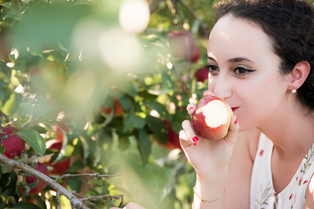 Eating red apple fall photo session