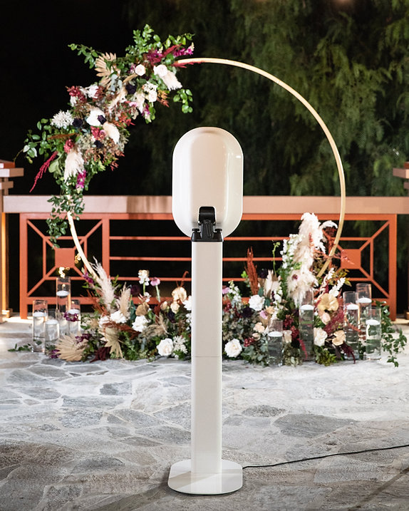 Photo booth rental with large floral hoop and candles