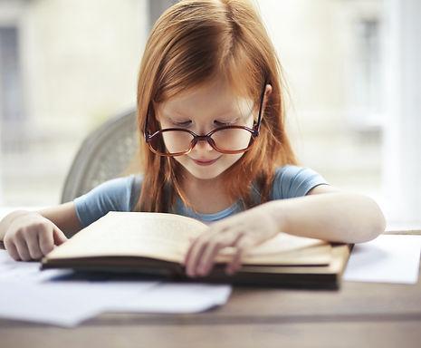 girl-in-blue-long-sleeve-shirt-reading-b