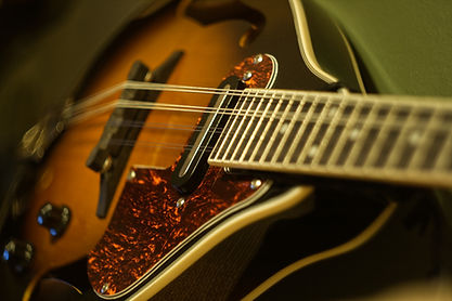 Close up of an Ibanez M510e-BS Mandolin