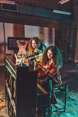 Rich Bond recording Georgia Harris from Loris and the Lion on a piano.