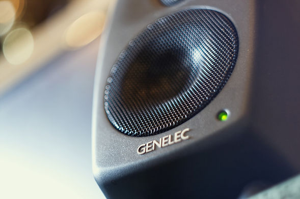 Close up of a Genelec 8010a studio monitor speaker