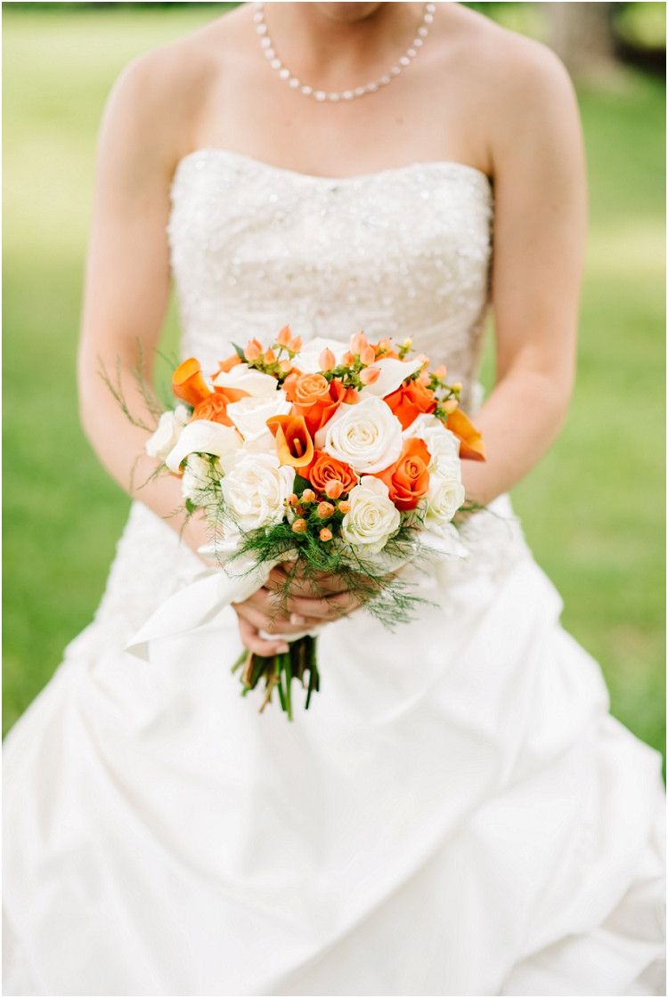 bride-with-wedding-bouquet-at-wisconsin-farm-wedding-by-green-bay-wedding-photographer-kyra-rane-photography