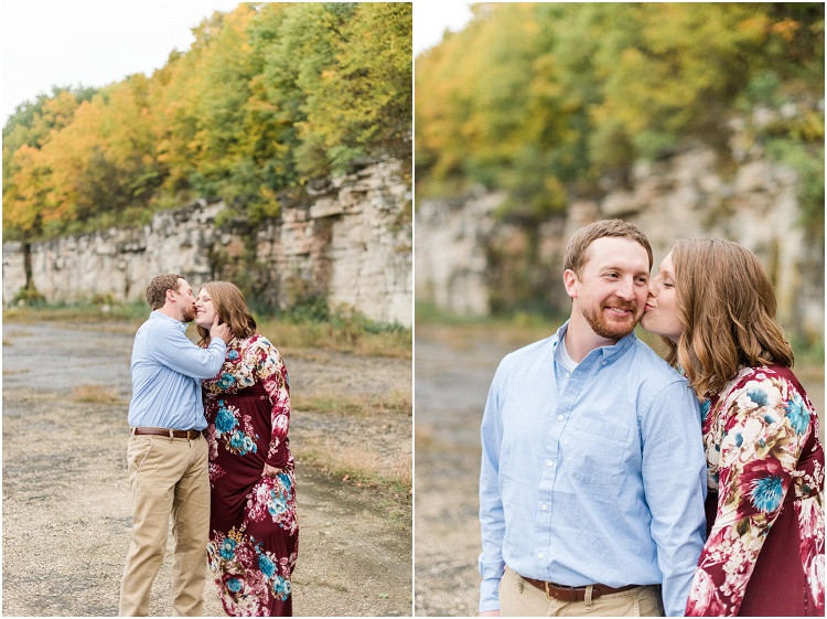 engaged couple-kiss-cheek-at-high-cliff-engagement-session-by-milwaukee-wedding-photographer-kyra-rane-photography