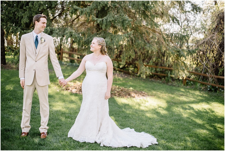 bride-and-groom-holding-hands-looking-at-each-other-at-minnesota-wedding-by-green-bay-wedding-photographer-kyra-rane-photography
