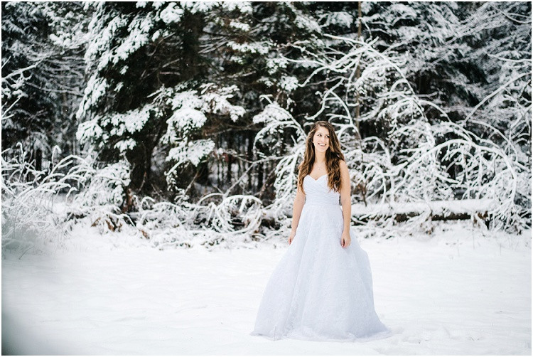 winter-bride-smiling-under-snow-at-wisconsin-winter-bridal-portraits-by-milwaukee-wedding-photographer-kyra-rane-photography