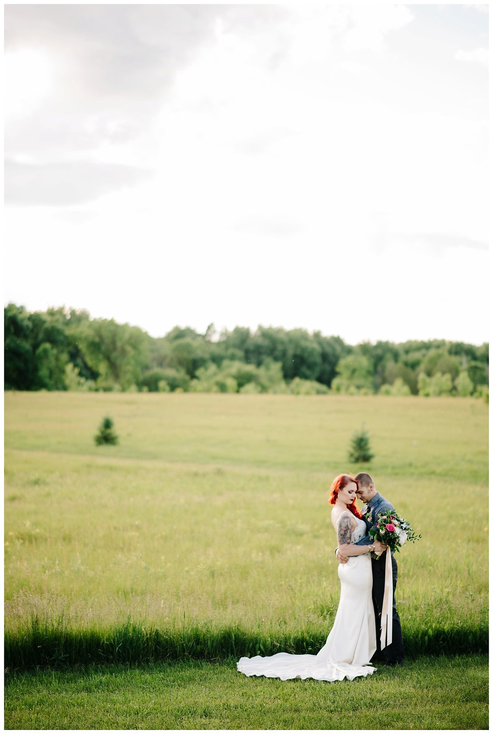 wedding-couple-nuzzle-close-in-field-at-homestead-meadows-styled-shoot-by-appleton-wedding-photographer-kyra-rane-photography