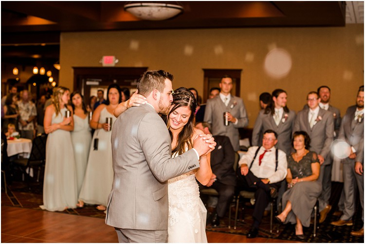 bride-and-groom-first-dance-kiss-at-de-pere-wisconsin-wedding-by-appleton-wedding-photographer-kyra-rane-photography