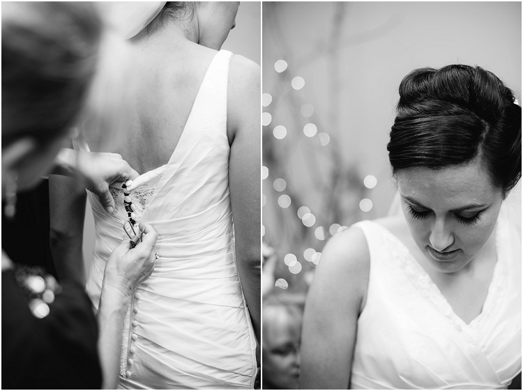 bride-buttoning-up-wedding-dress-at-de-pere-wedding-by-appleton-wedding-photographer-kyra-rane-photography