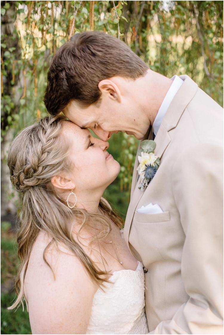 bride-and-groom-with-noses-together-at-minnesota-wedding-by-milwaukee-wedding-photographer-kyra-rane-photography