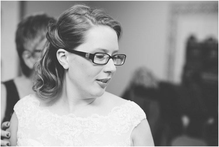 bride-getting-in-wedding-dress-at-sheboygan-winter-wedding-by-appleton-wedding-photographer-kyra-rane-photography