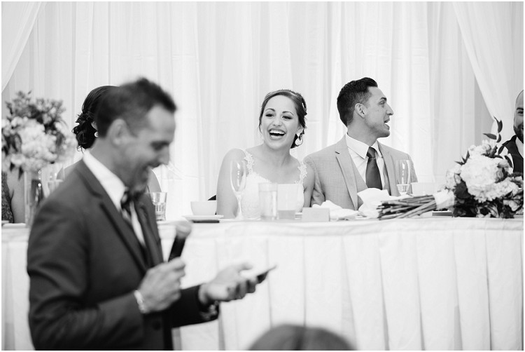 laughing-at-toasts-at-best-western-premier-waterfront-hotel-wedding-by-green-bay-wedding-photographer-kyra-rane-photography