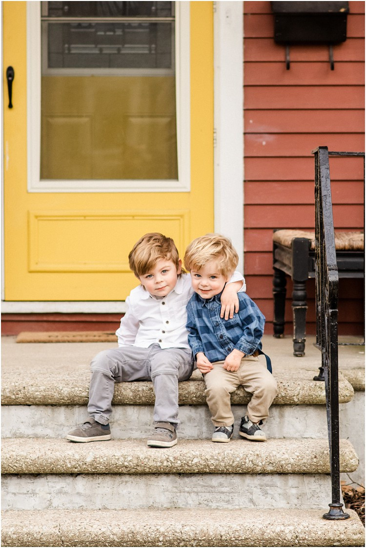 brothers-smiling-on-front-steps-at-the-front-porch-series-by-green-bay-wedding-photographer-kyra-rane-photography