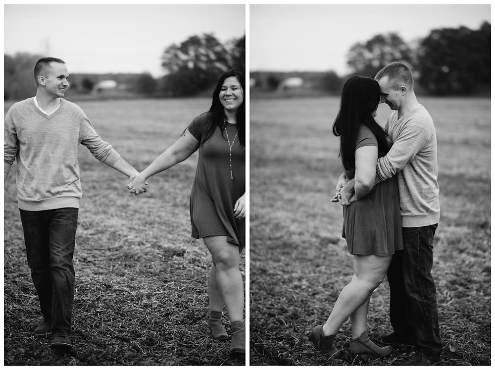 engaged-couple-holding-hands-in-field-at-green-bay-engagement-session-by-appleton-wedding-photographer-kyra-rane-photography