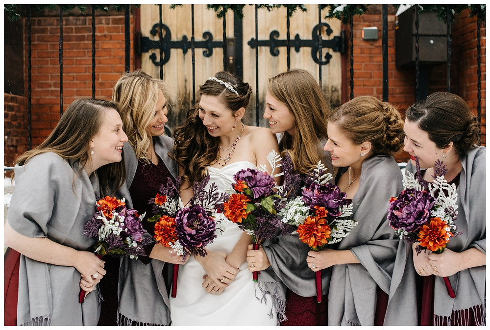 bridesmaids-smiling-at-each-other-at-milwaukee-wedding-by-green-bay-wedding-photographer-kyra-rane-photographer