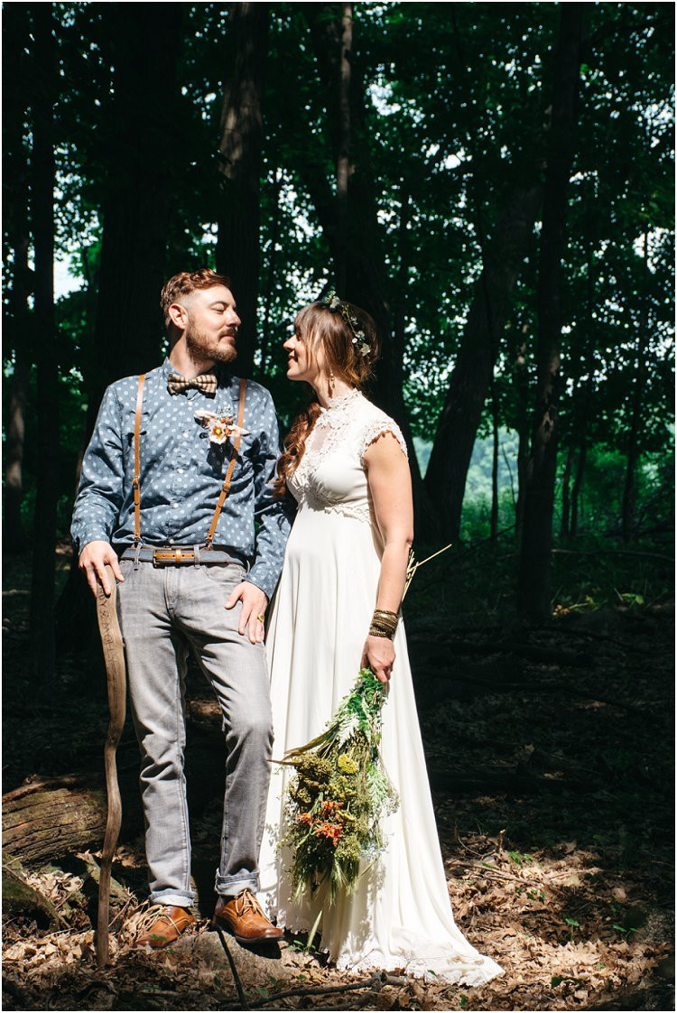 bride-and-groom-standing-in-forest-at-july-4th-elopement-by-green-bay-wedding-photographer-kyra-rane-photography