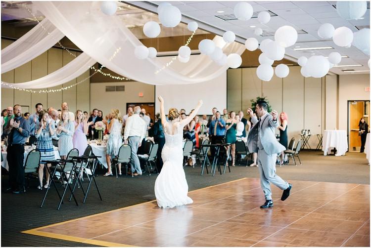 wedding-couple-grand-entrance-at-best-western-premier-waterfront-hotel-wedding-by-appleton-wedding-photographer-kyra-rane-photography