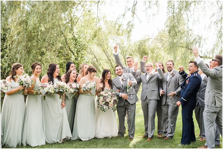 wedding-party-cheering-with-champagne-at-de-pere-wisconsin-wedding-by-appleton-wedding-photographer-kyra-rane-photography